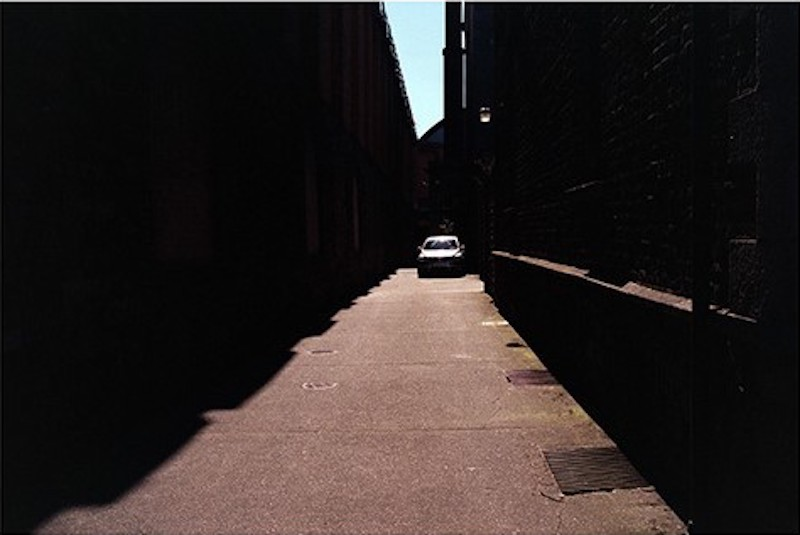 Untitled (car in alley)